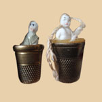Pair of Frozen Charlotte Thread Waxers with Thimbles